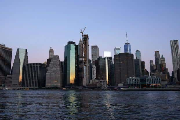 The lower Manhattan skyline is seen in the morning light on 4 September in the East River in New York. Photo: AFP