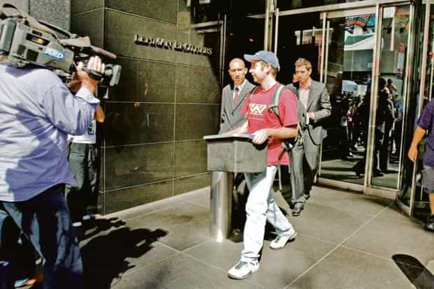 Three people exit the Lehman office in New York on 15 Sep 2008. When Wall Street fell 10 years ago, it changed global finance. Photo: Bloomberg