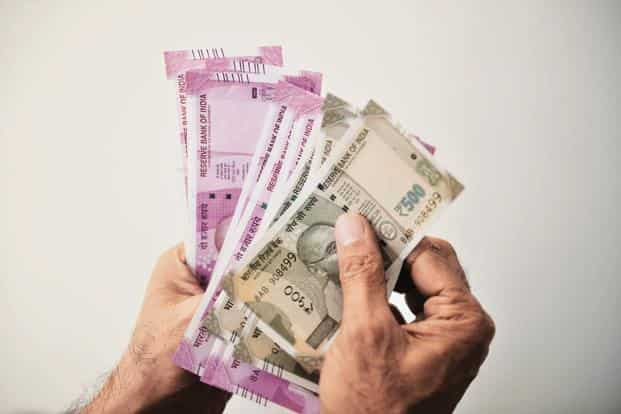 So far this year, the rupee has declined 12%, while foreign investors have sold $1.26 billion and $6.78 billion in the equity and debt markets, respectively. Photo: Mint