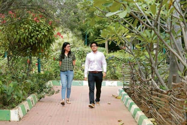 Archit Gupta (right) with a team mate at a park in Koramangala for a mobile meeting. Photo: Ramegowda Bopaiah/Mint