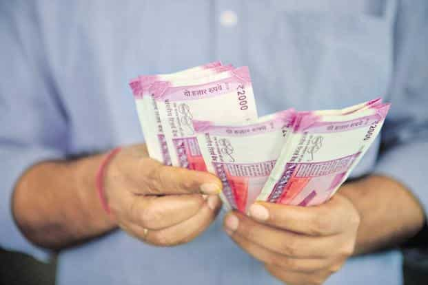 The rupee hit 73.4050 per dollar in early trade on Wednesday, an all-time low. Photo: Mint