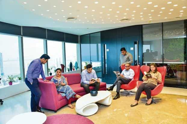 In the lobby at Siemens India's Mumbai office, employees take time out to catch up on some reading. Photo: Aniruddha Chowdhury/Mint