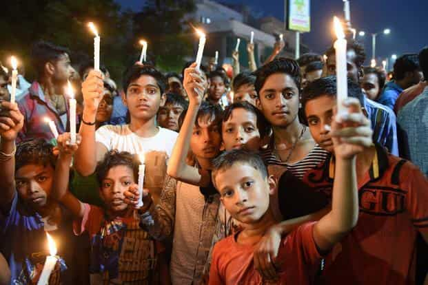 A candle-light protest against the rape of a 14-month-old girl in Himmatnagar, Gujarat, in Ahmedabad on Sunday. Photo: Sam Panthaky/AFP