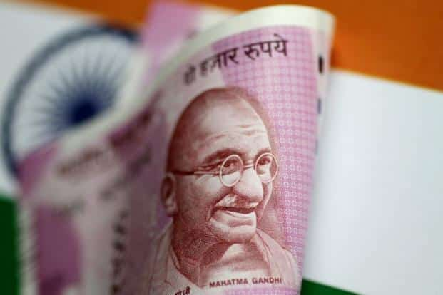 India is seeking to boost flows to support its currency that has declined more than 14% against the dollar this year, Asia's worst performer. Photo: Reuters