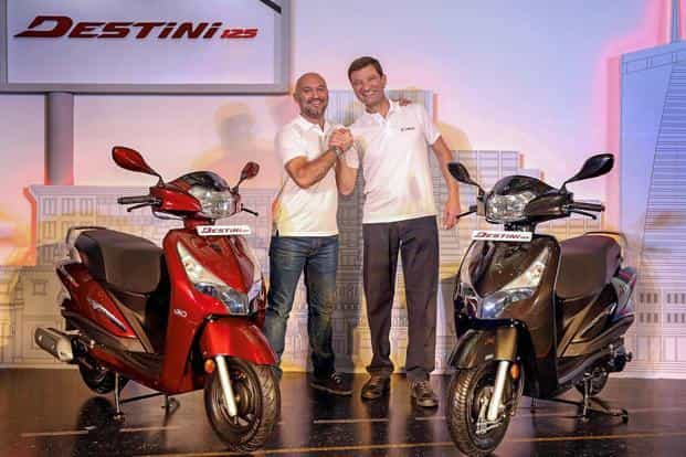 Hero MotoCorp Ltd chief technology officer Markus Braunsperger (R) with Head of global product planning Malo Le Masson during launch of scooter Destini 125 in New Delhi on Monday. Photo: PTI