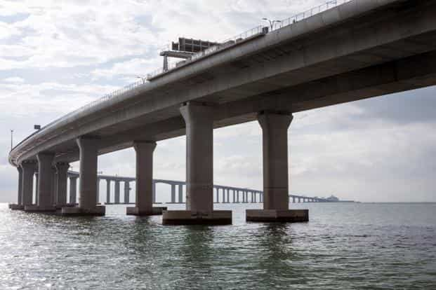 The $15 billion, 55km bridge is the world's longest sea link and is tipped to carry some 29,000 cars and trucks daily between Zhuhai on the mainland and Hong Kong. Photo: Bloomberg