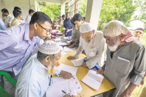 People checking their names on the final draft of the state's National Register of Citizens after it was released. Photo: PTI