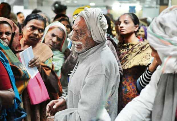 An old man crying for missing his spot in the long queue at a State Bank of India branch during demonetization. Photo: Hindustan Times