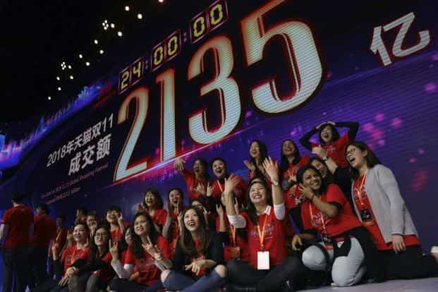 Alibaba employees after Singles' Day set a new record of more than US$30 billion in sales in Shanghai, China, on Monday. Photo: AP