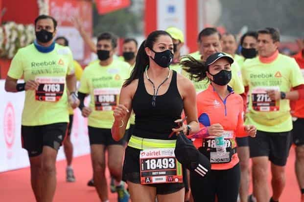 Participants wore masks and took part in the Airtel Delhi Half Marathon last year. Photo: Getty Images