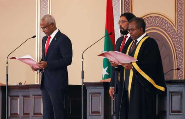 Maldives' President-elect Ibrahim Mohamed Solih (L) takes the oath conducted by Chief Justice Dr Ahmed Abdulla Didi (R) during the swearing-in ceremony in Male, Maldives. Photo: Reuters