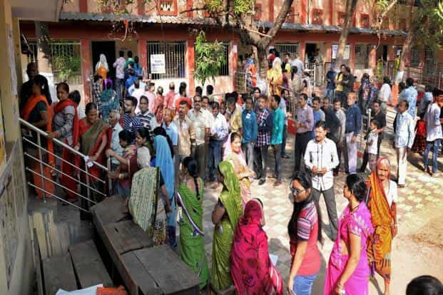 Voters at a polling station in Raipur on Tuesday. Polling was peaceful and incident-free in the second phase. Photo: PTI