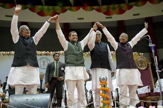Congress president Rahul Gandhi (2nd L) with newly sworn-in Chhattisgarh chief minister Bhupesh Baghel (L), cabinet ministers T.S. Singh Deo and Tamradhwaj Sahu (R), during the oath-taking ceremony in Raipur on Monday. Photo: PTI