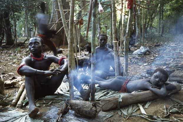 A file photo of members of a Jarawa community near a wood fire in their temporary encampment. Photo: Getty Images