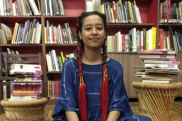 Aqui Thami, the artist-activist founder of Sister Library.