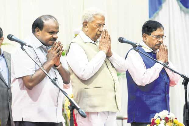 (From left) Karnataka chief minister H.D. Kumaraswamy, governor Vajubhai Vala and deputy CM G. Parameswara during the swearing-in ceremony for the cabinet expansion in Bengaluru.Photo:PTI