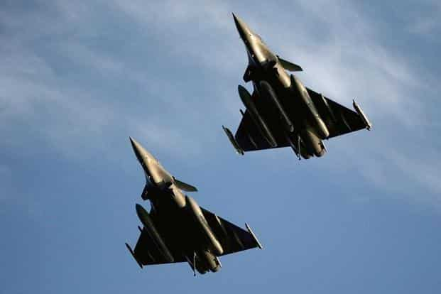 PM Narendra Modi announced India's decision to buy 36 jets off the shelf in a government-to-government agreement in April 2015, cancelling the UPA government's 2012 decision to buy 18 Rafale jets in fly-away condition and manufacture 108 in India. Photo: AP