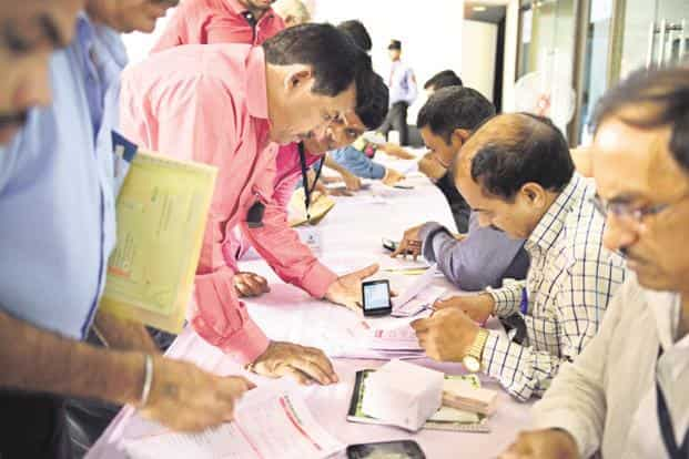 Tax department organised special camp for government employee to help file their taxes. Photo: Pradeep Gaur/Mint