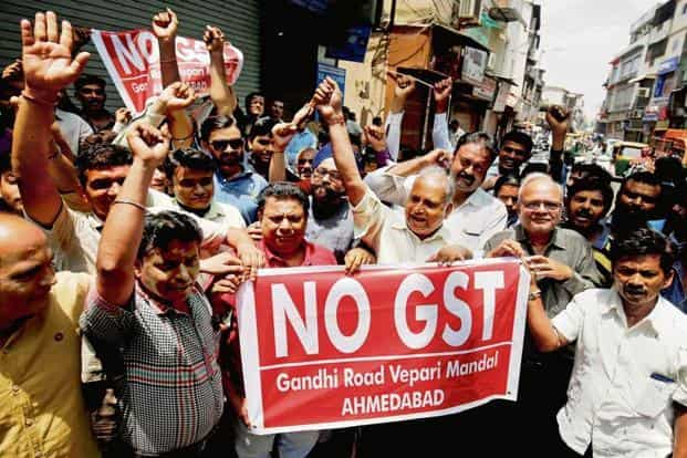 A uniform GST rate will improve compliance, completely do away with distortion and promote growth and employment. Photo: PTI