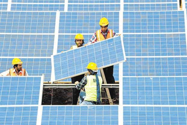 India's renewable energy space is witnessing consolidation in the backdrop of considerable overseas interest. Photo: AFP