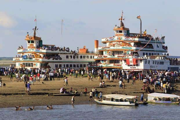 People mill around the banks of the Itaya River during the inauguration festival. (Reuters)