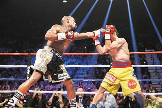 Floyd Mayweather Jr (left) and Manny Pacquiao fight during a title match on 2 May. Photo: AFP