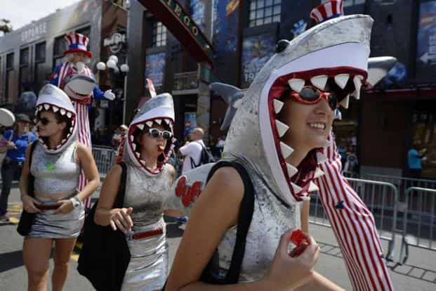 Attendees in shark uniforms head to the four-day convention.